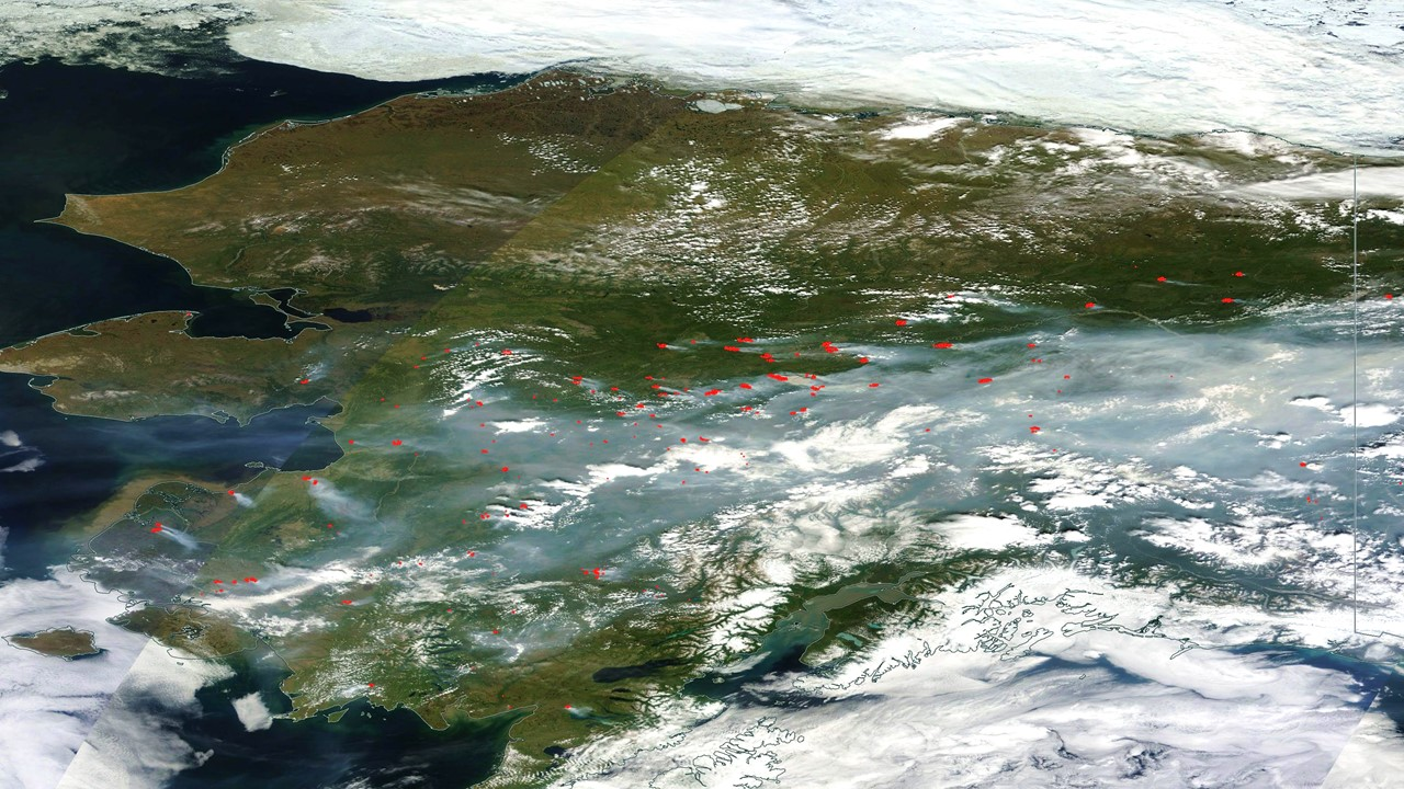 NASA MODIS satellite imagery of Alaska from 23 June 2015 showing infrared-sensed fire hotspots (red) dots from 260+ wildfires.